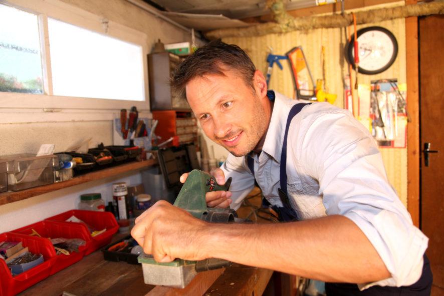 Joiner working wood in workshop